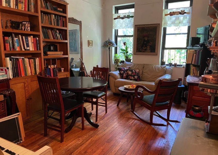 apartment photo with living space and library with books