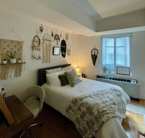 photo of two bedroom apartment with bed and wall decorations